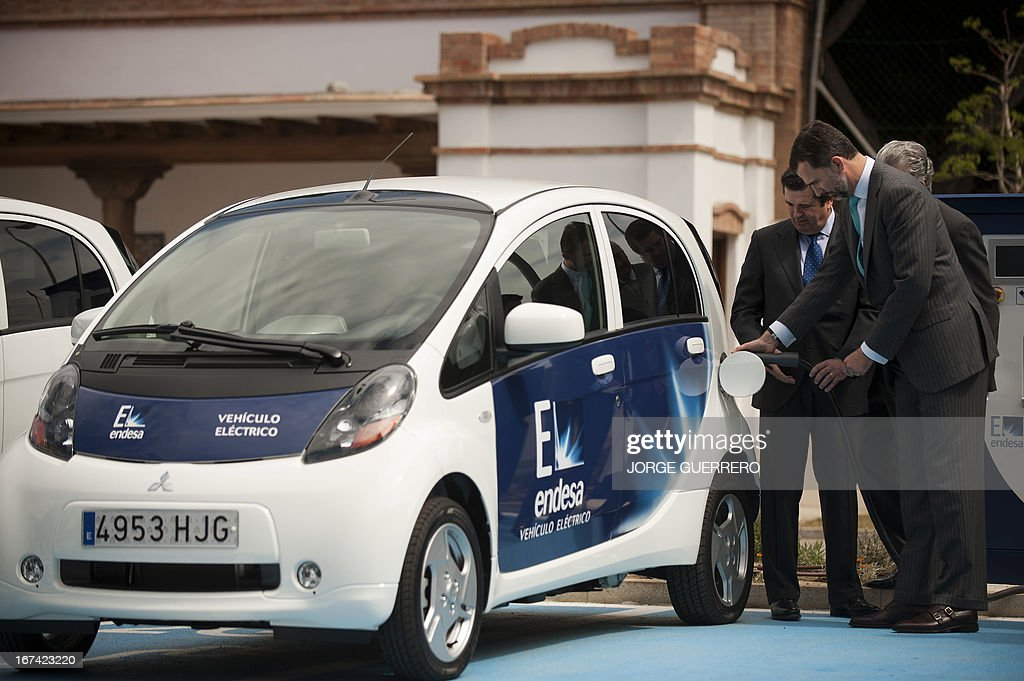 Spanish Crown Prince Felipe (R) inaugurates the project 'Zem2All' at the Automobile museum in Malaga on April 25, 2013. Zem2All is a pilot project, carried out alongside the Japanese government, designed to estimate usage by drivers of electric vehicles in Malaga and provide an in-depth study of the impact of these vehicles. For the four-year project 229 recharging points have been installed throughout the city and 200 e-vehicles have been distributed to participants in the project.