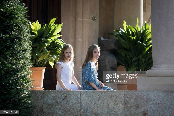 Spanish crown princess Leonor and princess Sofia pose in the gardens at the Marivent Palace on the island of Mallorca on July 31 2017 The royal...