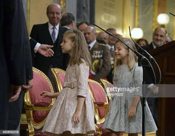 Spanish Crown Princess of Asturias Leonor and princess Sofia stand during a swearing in ceremony for FelipeVI King of Spain at the Congress of...