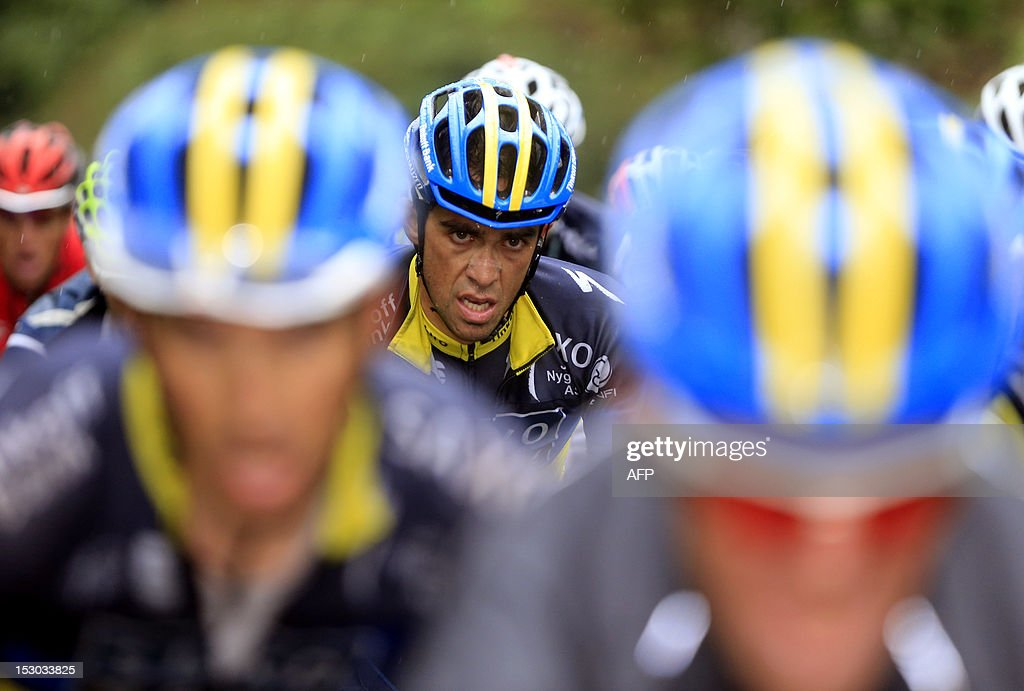 Spanish cyclist Alberto Contador competes under heavy rain near Muro di Sormano on September 29, 2012, during the 106th Giro di Lombardia (Tour of Lombardy), a 251kms race from Bergamo to Lecco. AFP PHOTO / LUK BENIES
