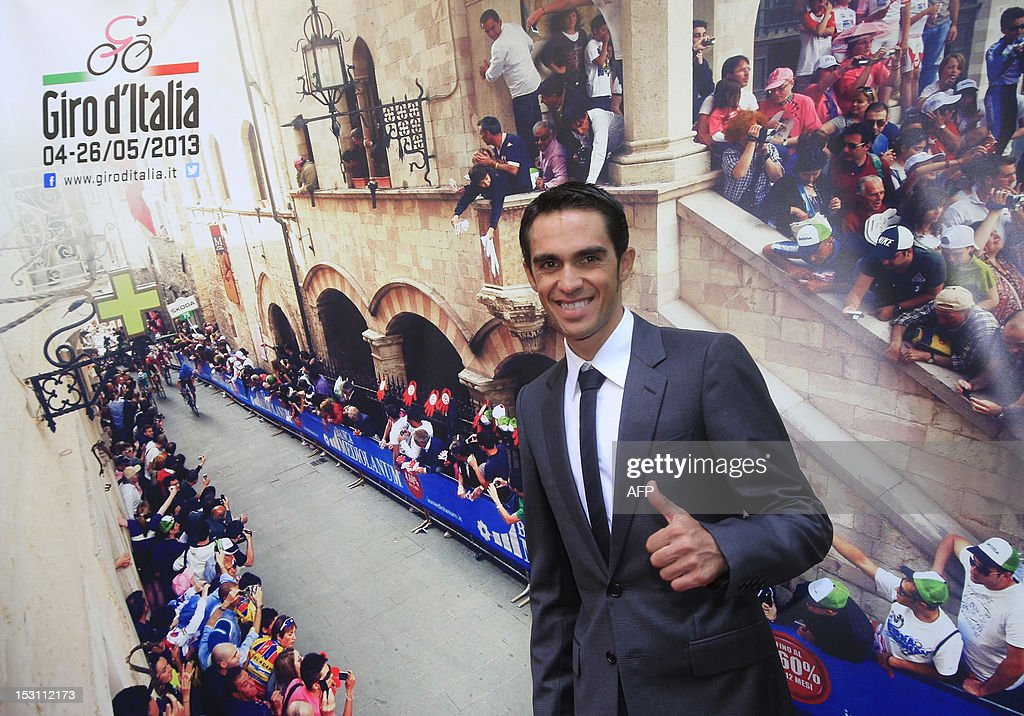Spanish cyclist Alberto Contador gestures during the presentation of the 96th Giro d'Italia (Tour of Italy) 2013 route on September 30, 2012, in Milan. The 2013 Giro d'Italia includes nearly 75 km of time trials for a total race distance of 3400 km. It will start in Naples on May 4 and finish in Brescia on May 26.