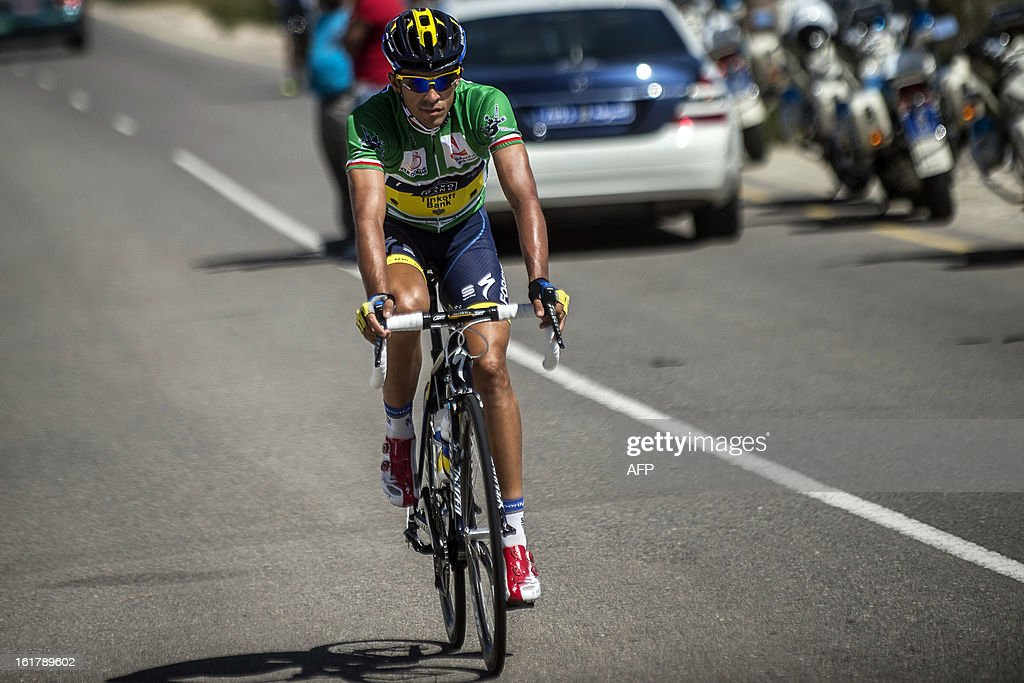 Spanish cyclist Alberto Contador of Saxo-Tinkoff team prepares before the start of the sixth and last stage of the Tour of Oman, on February 16, 2013. The final stage was a 144km ride from Hawit Nagam park in the south of the emirate to Muscat along the Matrah corniche. AFP PHOTO / JEFF PACHOUD