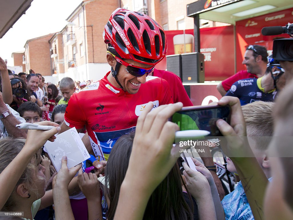 Spanish cyclist Alberto Contador of the Saxo Bank-Tinkoff Bank Team signs autographs before the nineteenth stage of the Vuelta tour of Spain cycling rqace, a 178,4 kms ride from Penafiel to La Lastrilla, on September 7, 2012. AFP PHOTO / Jaime REINA