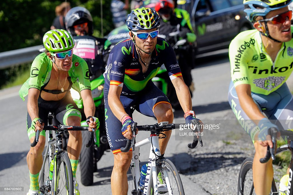 Spanish cyclist Alejandro Valverde (C) of Movistar team rides during the Colle dell'Agnello downhill as part of the 19th stage of the 99th Giro d'Italia, Tour of Italy, from Pinerolo to Risoul on May 27, 2016. Italy's Vincenzo Nibali of Astana escaped alone to a summit-finish victory today whilst Colombia's Esteban Chaves rode into the pink jersey by coming third on the day. Pre-race favourite Italy's Vincenzo Nibali had been thought to be dead and buried on this Giro after dropping to fifth, but is now just 44seconds off new leader Chavez, in second place, ahead of another mountain stage on Saturday. BENIES