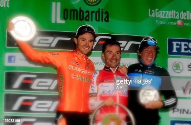 Spanish cyclist Joaquim Rodriguez of Team Katusha Spanish second placed Samuel Sanchez and Colombian third placed Rigoberto Uran Uran celebrate on...