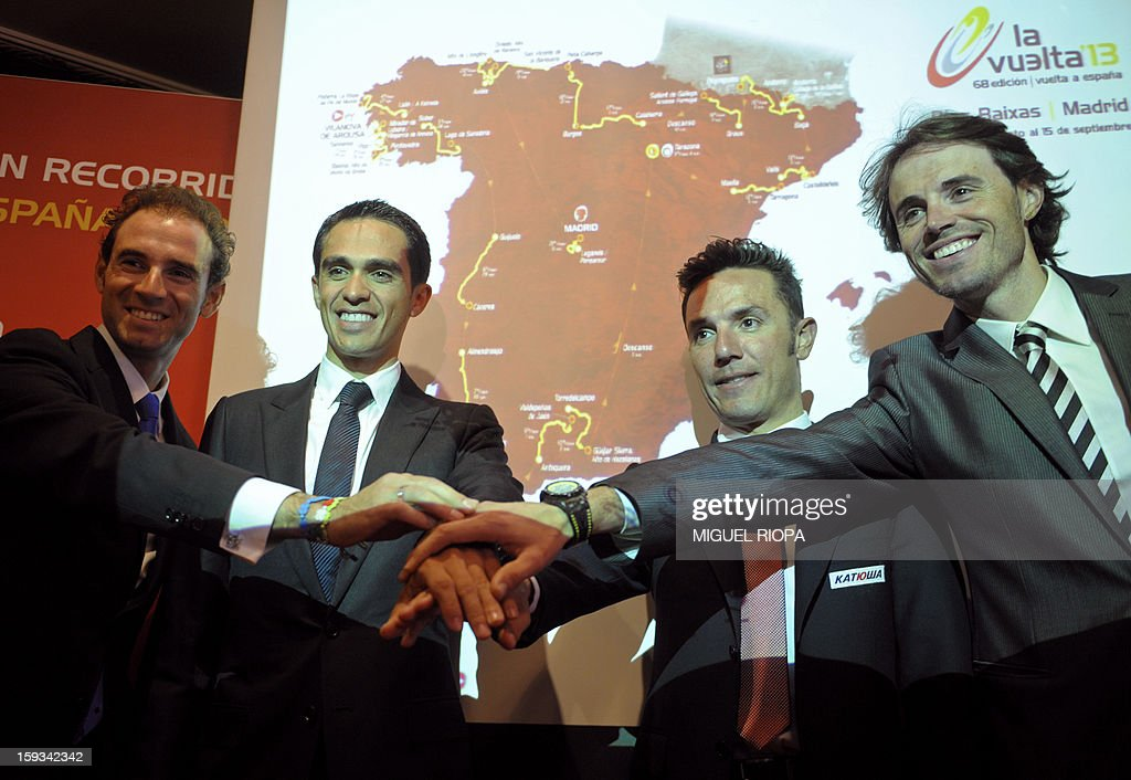Spanish cyclists, Alejandro Valverde, Vuelta 2012's winner Alberto Contador, Joaquin 'Purito' Rodriguez and Samuel Sanchez, pose during the presentation of the 68th Vuelta cycling tour of Spain in Vigo, on January 13, 2013. AFP PHOTO/ MIGUEL RIOPA
