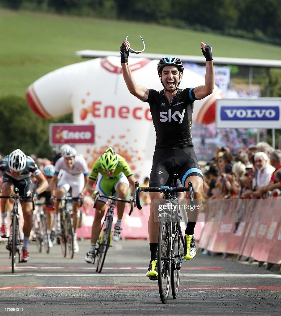 Spanish cyclsit David Garcia Lopez of Team Sky celebrates as he crosses the finish to win the sixth stage of the Eneco Tour cycling race, from Riemst to La Redoute, in Aywaille, on August 17, 2013. The event, formerly known as the Tour of Benelux, takes the peloton through Belgium and the Netherlands over seven stages and 1,080km.