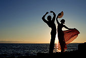 spanish dancers dancing by the sea in spain