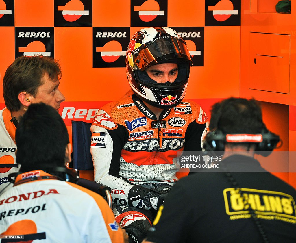 Spanish Dani Pedrosa of Respol Honda team speaks with his mechanichs, during the MotoGP qualification section of the Italian Grand Prix at Mugello track on June 05, 2010. Spain Dani Pedrosa of Respol Honda team took the best position ahead of Spanish Jorge Lorenzo of Yamaha and Australian Casey Stoner of Ducati team.