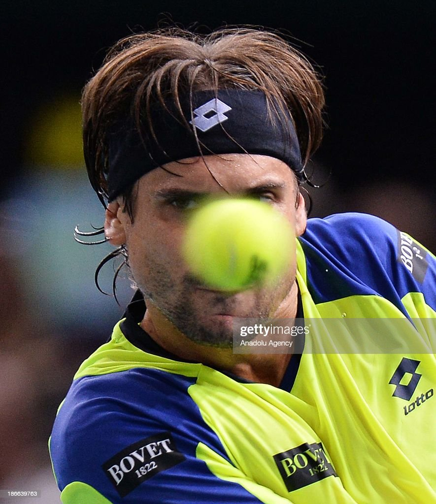 Spanish David Ferrer returns the ball to his compatriot Rafael Nadal during the men's single semi final match at the BNP Paris Masters tennis tournament at Bercy Arena on November 2, 2013 in Paris, France.