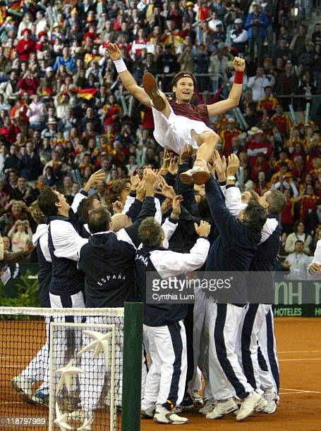 Spanish Davis Cup team celebrates Carlos Moya's 62 76 76 win over Andy Roddick at the Davis Cup Championship on December 5 2004 in Seville Spain at...
