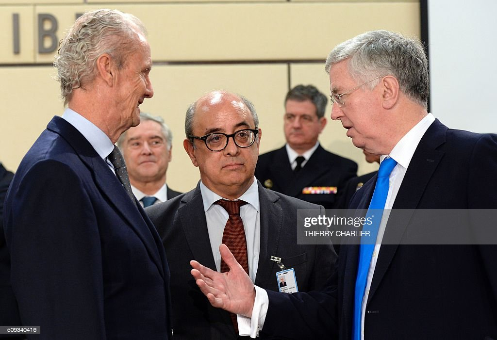 Spanish Defence Minister Pedro Morenes Eulate (L, Portugal's Defence Minister Jose Alberto Azeredo Lopes (C) and British Defence Minister Michael Fallon (R) talk together prior to a meeting of the North Atlantic Council (NAC) of Defence Ministers at the NATO headquarters in Brussels, February 10, 2016. NATO defence ministers convene a two-day meeting to discuss current defense issues and whether the Alliance should take a more direct role in dealing with its gravest migrant crisis since Worl War II. / AFP / THIERRY CHARLIER