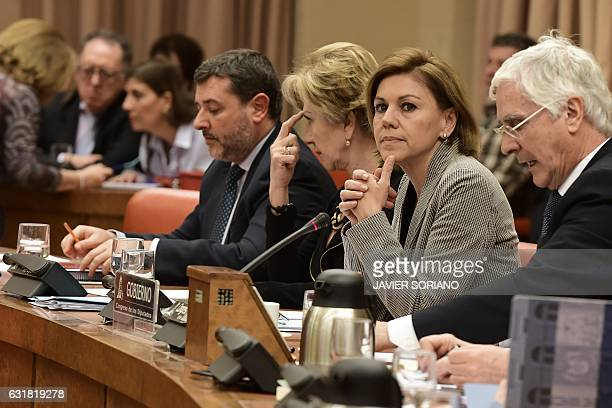 Spanish Defense Minister Maria Dolores de Cospedal looks on past Socialist Party deputy Jose Maria Barreda before giving explanations pertaining to...