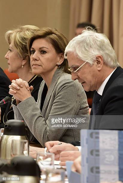 Spanish Defense Minister Maria Dolores de Cospedal past Socialist Party deputy Jose Maria Barreda before giving explanations pertaining to the 2003...