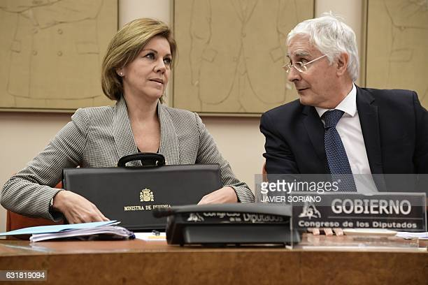 Spanish Defense Minister Maria Dolores de Cospedal speaks with Socialist Party deputy Jose Maria Barreda before giving explanations pertaining to the...