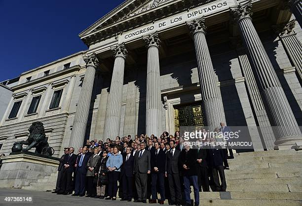 Spanish deputees observe a minute of silence outside the 'Las Cortes' in Madrid on November 16 2015 to pay tribute to victims of the attacks claimed...
