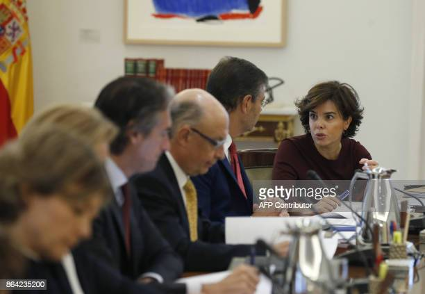 Spanish Deputy Prime Minister and Minister of the Presidency and of the Regional Administrations Soraya Saenz de Santamaria attends a crisis cabinet...