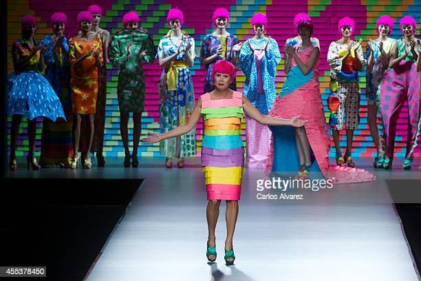 Spanish designer Agatha Ruiz de la Prada walks the runway at the end of Agatha Ruiz de la Prada fashion show during Mercedes Benz Fashion Week Madrid...
