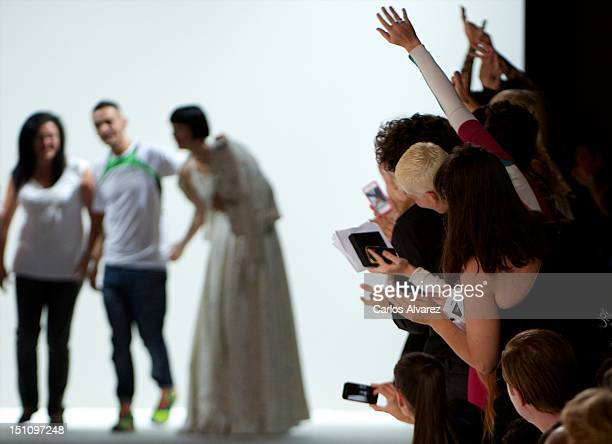 Spanish designer David Delfin walks the runway at the end of the Davidelfin fashion show during the Cibeles Madrid Fashion Week Spring/Summer 2013 at...