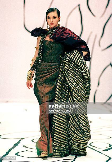 Spanish designer Emanuel Ungaro shows his pleated brown taffeta evening dress with a red green and gold taffeta cape as part of his 1993/94...