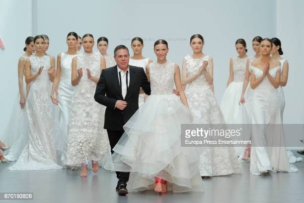 Spanish designer Hannibal Laguna and model Anna Barrachina attend the Hannibal Laguna show during the runway at the Hannibal Laguna show during the...
