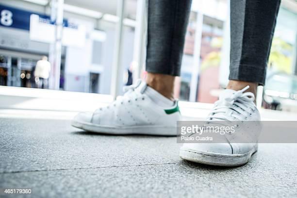 Spanish Designer Juanjo Oliva wears Adidas trainers Zara trousers Alexander Wang pullover and Juanjo Oliva coat on March 3 2015 in Madrid Spain