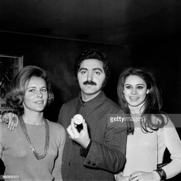 Spanish designer Paco Rabanne poses with members of the women's jury MarieLaure Prouvost and Corinne Piccoli on February 29 after being awarded...