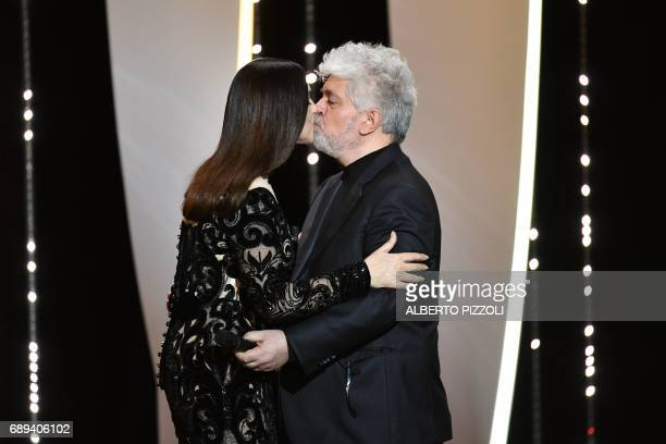 Spanish director and President of the Feature Film Jury Pedro Almodovar kisses Italian actress and master of ceremonies Monica Bellucci as he arrives...