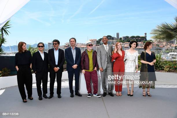 Spanish director and President of the Feature Film Jury Pedro Almodovar poses on May 17 2017 with jury members German director Maren Ade South Korean...