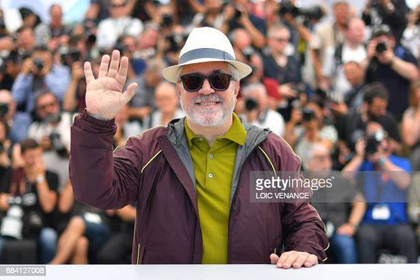 Spanish director and President of the Feature Film Jury Pedro Almodovar waves on May 17 2017 during a photocall ahead of the opening ceremony of the...