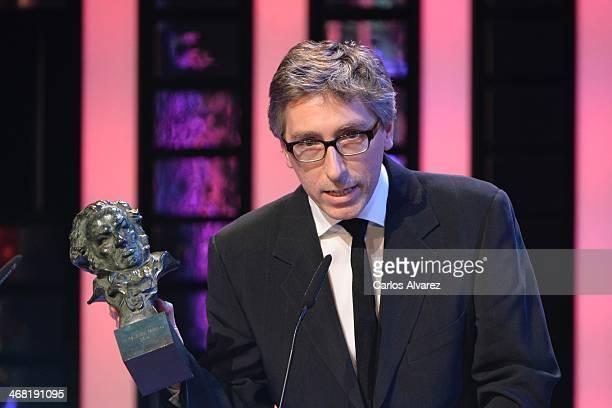Spanish director David Trueba receives the Goya award for best director and best film for his film 'Vivr es facil con los ojos cerrados' during the...