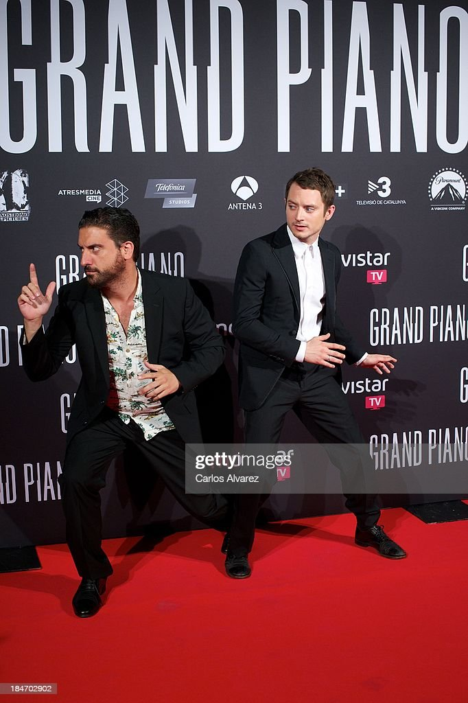 Spanish director Eugenio Mira (L) and actor <a gi-track='captionPersonalityLinkClicked' href=/galleries/search?phrase=Elijah+Wood&family=editorial&specificpeople=171364 ng-click='$event.stopPropagation()'>Elijah Wood</a> (R) attend 'Grand Piano' premiere at the Callao cinema on October 15, 2013 in Madrid, Spain.
