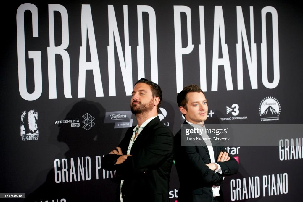 Spanish director Eugenio Mira (L) and actor <a gi-track='captionPersonalityLinkClicked' href=/galleries/search?phrase=Elijah+Wood&family=editorial&specificpeople=171364 ng-click='$event.stopPropagation()'>Elijah Wood</a> (R) attend 'Grand Piano' premiere at the Capitol Cinema on October 15, 2013 in Madrid, Spain.