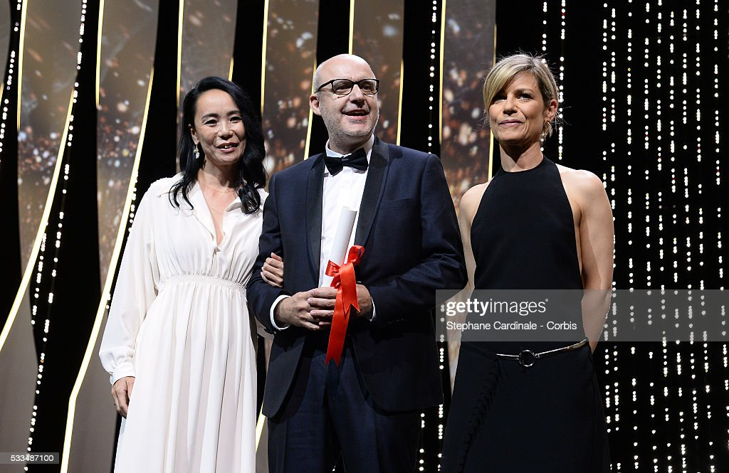Spanish director Juanjo Gimenez poses with the Palme d'Or award for Best Short Film for 'Timecode' next to President of the Cinefondation and Short Films Jury <a gi-track='captionPersonalityLinkClicked' href=/galleries/search?phrase=Naomi+Kawase&family=editorial&specificpeople=3267953 ng-click='$event.stopPropagation()'>Naomi Kawase</a> (L) and actress Marina Foys at the Closing Ceremony at the annual 69th Cannes Film Festival at Palais des Festivals on May 22, 2016 in Cannes, France.