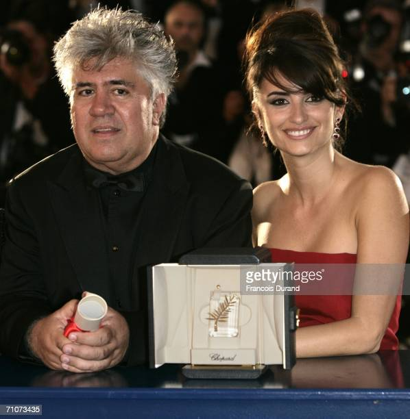 Spanish director Pedro Almodovar and actress Penelope Cruz pose with the Best Screenplay Award at the Palme d'Or Award Closing Ceremony during the...