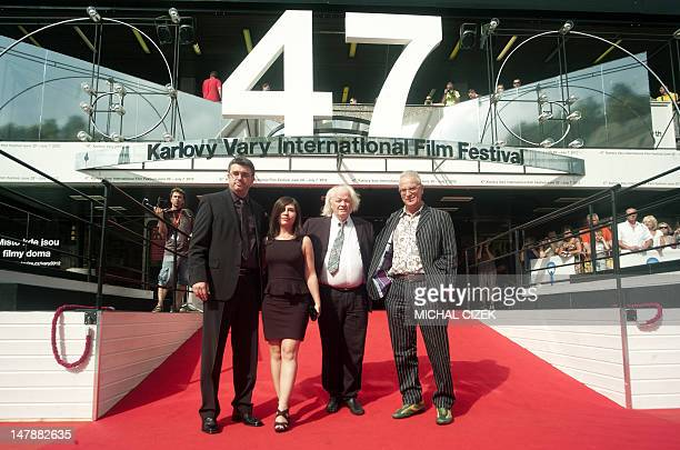 Spanish director Pere Vila i Barcelo his wife and screenwriter Monice Garcia Massague Spanish actor Lou Castel and Spanish producer Luis Minarro pose...