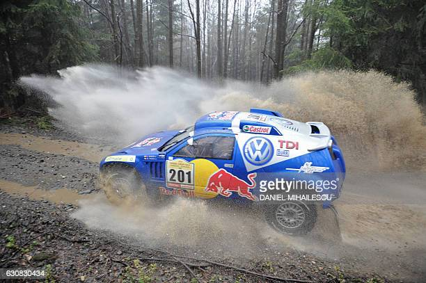 Spanish driver Carlos Sainz and French copilot Michel Perin aboard their Volkswagen compete during the third stage of the Central European Rally near...
