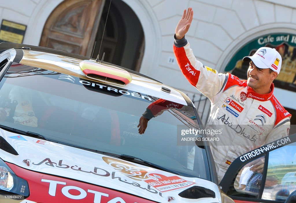 Spanish driver Dani Sordo of Citroen DS3 WRC salutes his fans during the opening ceremony of the FIA World Rally Championship of Italy in Sassari, on the Italian island of Sardinia on June 20, 2013.