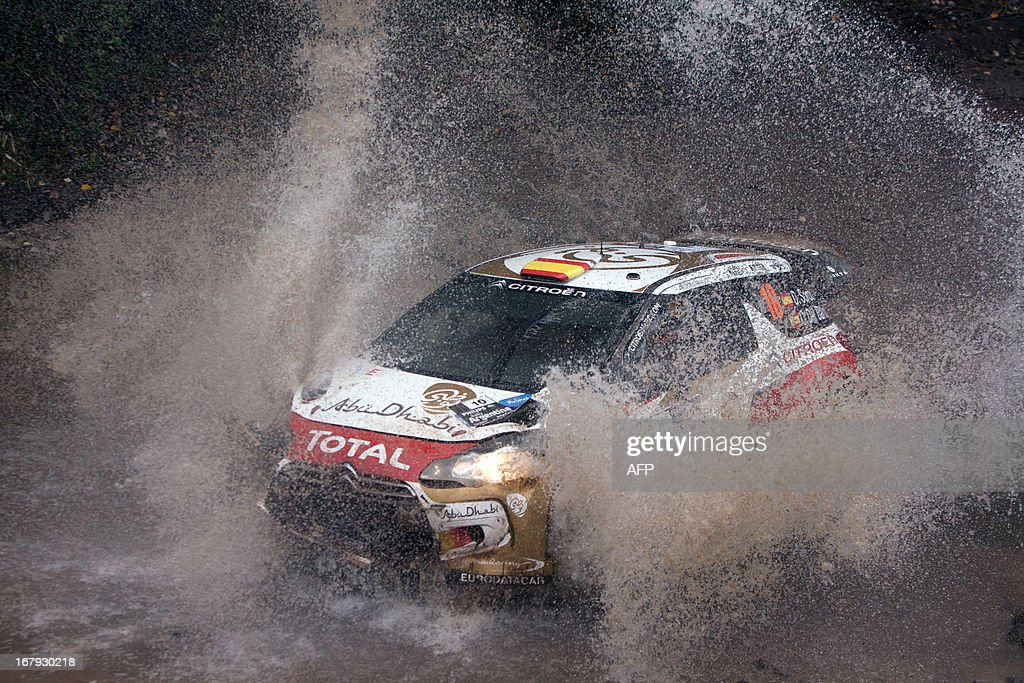 Spanish driver Daniel Sordo steers his Citroen DS3 WRC with compatriot co-driver Carlos Del Barrio after crashing during the 3rd stage of the WRC Argentina 2013 near Agua de Oro, Cordoba, on May 2, 2013. AFP PHOTO / Diego LIMA