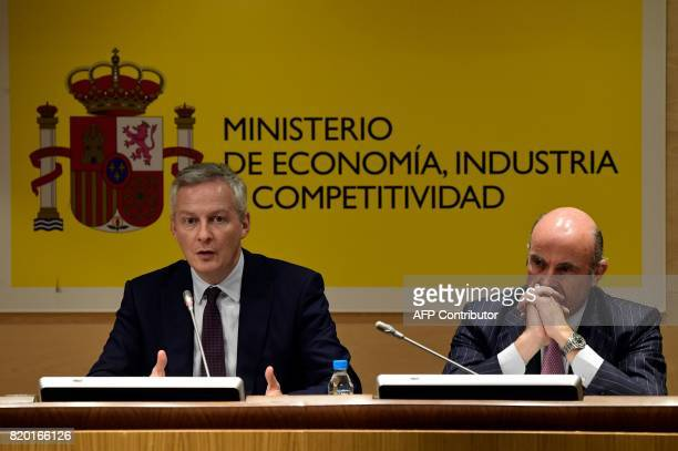 Spanish Economy Minister Luis de Guindos and his French counterpart Bruno Le Maire give a press conference at the Economy Ministry headquarters in...