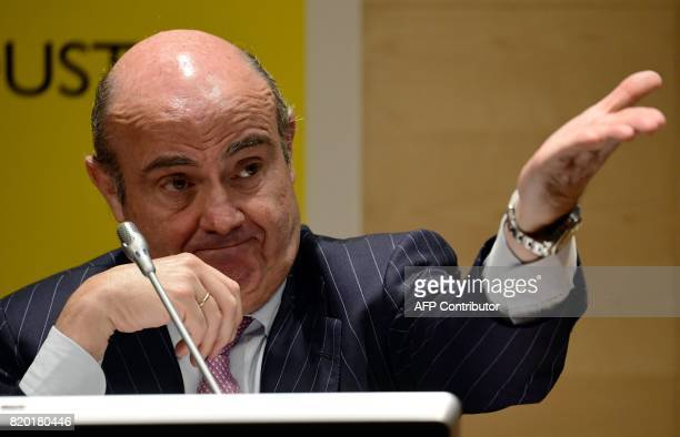 Spanish Economy Minister Luis de Guindos gestures during a joint press conference with his French counterpart at the Economy Ministry headquarters in...