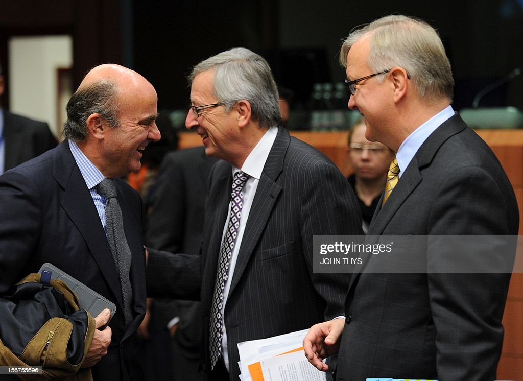 Spanish Economy minister Luis de Guindos Jurados (L) talks with Luxembourg Prime Minister and Eurogroup Council President Jean-Claude Juncker (C) and EU commissioner for Economic and Monetary Affairs Olli Rehn (R) , before an Eurozone finance ministers meeting to decide on a fresh rescue loan for debt-stricken Greece, on November 20, 2012 at EU headquarters in Brussels. Greece has 'delivered' on reform and a deal will likely be clinched to unblock funds to keep it from bankruptcy, the head of the Eurogroup insisted despite a split with the IMF over how to get the stricken country's economic recovery on track.