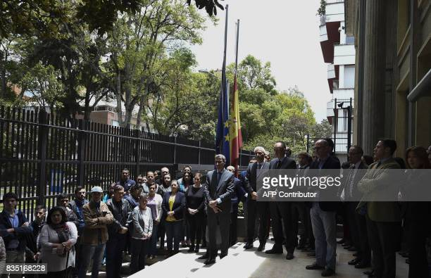 Spanish embassy staffers and Colombian people hold a minute's silence for the victims of the terrorist attacks in Spain in Bogota on August 18 2017...