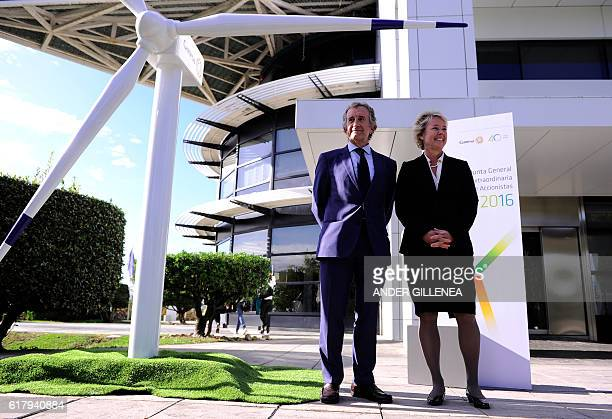 Spanish energy company Gamesa's chairman Ignacio Martin and member of the Managing Board of Siemens AG Lisa Davis pose before a extraordinary meeting...