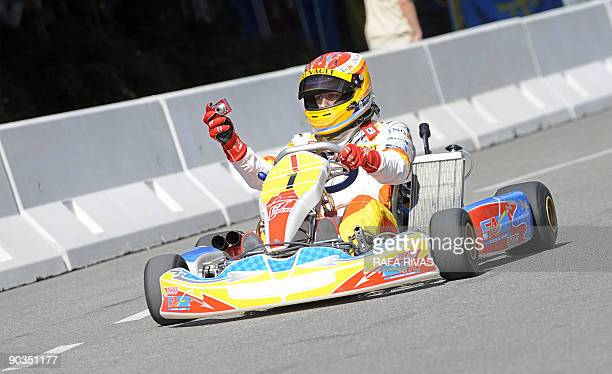 Spanish F1 driver Fernando Alonso takes a picture while he drives a kart during a Renault Road Show celebrated in his home town of Oviedo northern...