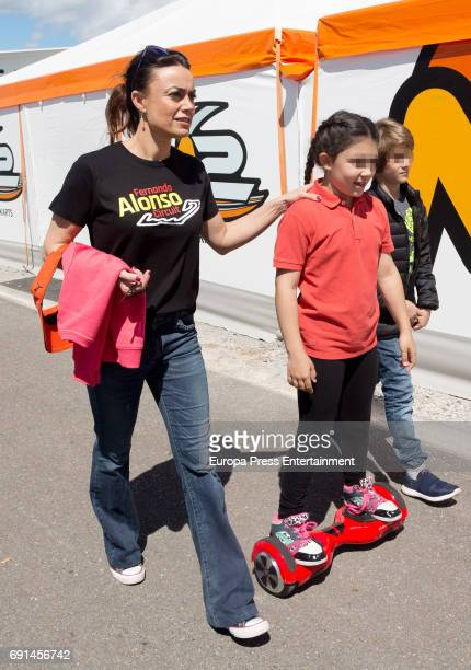 Part of this image has been pixellated to obscure the identity of the child Spanish F1 driver Fernando Alonso's sister Lorena Alonso attends the...