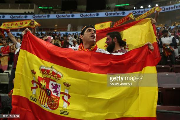 A Spanish fan waves the national flag during the 24th Men's Handball World Championships Eighth Final EF6 match between Spain and Tunisia at the...