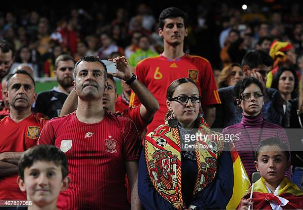 Spanish fans hold a minute of silence in honour of the victims of the Airbus A320 Germanwings passenger plane that crashed Tuesday in the Frence Alps...