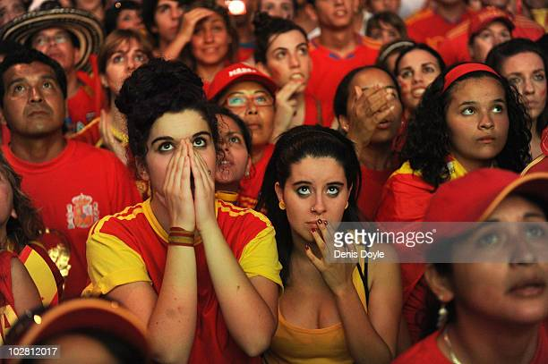 Spanish fans react during a public viewing of the Spain v Holland FIFA World Cup Final on July 11 2010 in Madrid Spain