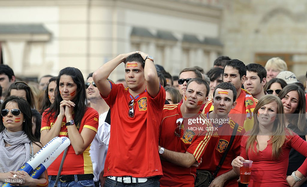 Spanish fans react during the screening of the Group H first round 2010 World Cup football match Switzerland vs Spain held in South Africa, at the Old Town Square on June 16, 2010 in Prague. Switzerland defeated Spain 1-0. The victory was Switzerland's first-ever over Spain in 19 games dating back 85 years. PHOTO